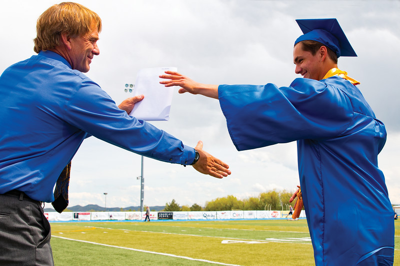 Matthew Gaston | The Sheridan Press<br>Scott Stults beams as he presents his son Cody Stults with his diploma during the Sheridan High School commencement Sunday, May 26, 2019.