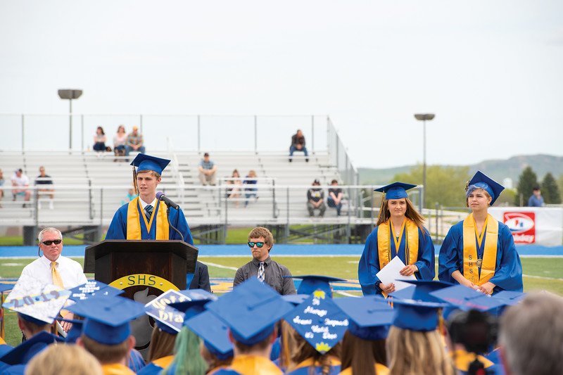 Matthew Gaston | The Sheridan Press<br>Sheridan's salutatorians, from left, Johnathan Briggs, Rachel Petersburg and Marissa Brenneman each took a turn to speak to their fellow graduates during the commencement ceremony at Homer Scott Field Sunday, May 26, 2019.