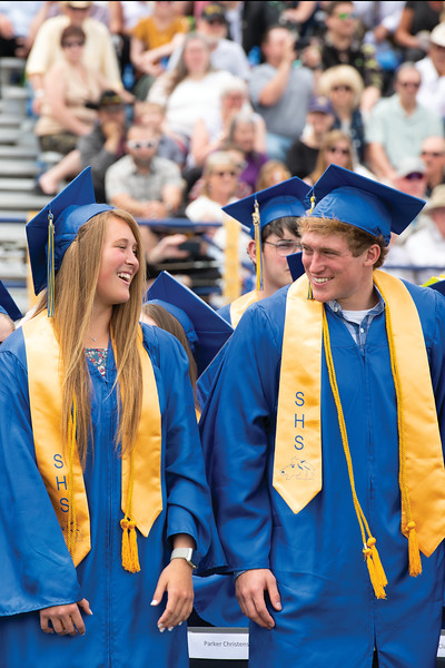 Matthew Gaston | The Sheridan Press<br>Jordan, left, and Parker Christensen share a moment between them during Sheridan High School's commencement ceremony Sunday, May 26, 2019.