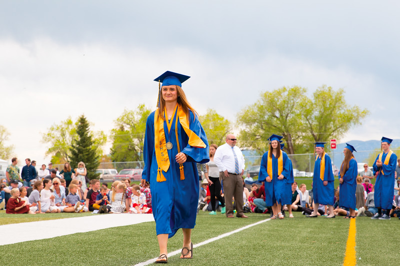 Matthew Gaston | The Sheridan Press<br>Salutatorian Rachel Petersburg smiles as she walks to collect her diploma during the Sheridan High School commencement Sunday, May 26, 2019.