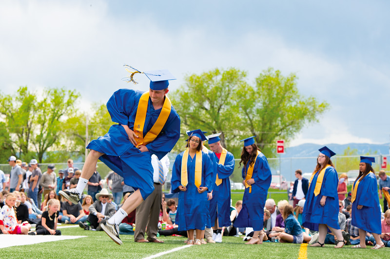 Matthew Gaston | The Sheridan Press<br>As his name is called to receive his diploma, Carter Wells, jumps and clicks his heels during the class of 2019 commencement at Sheridan High School Sunday, May 26, 2019.