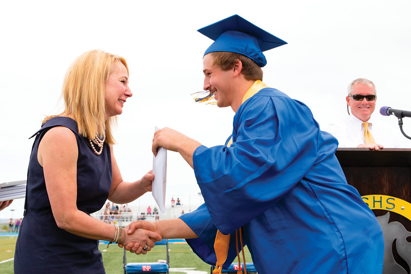 Matthew Gaston | The Sheridan Press<br>School board trustee Arin Waddell is overcome with pride as she presents her son Quinn Heyneman with his diploma during the Sheridan High School commencement Sunday, May 26, 2019.