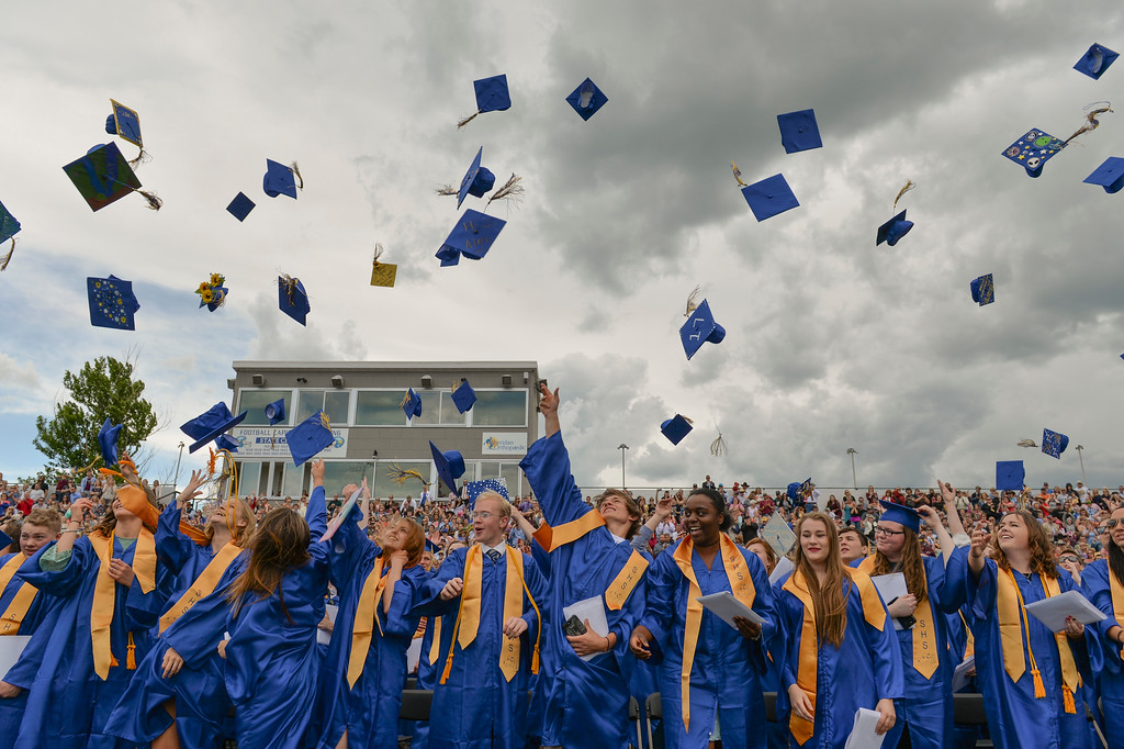 Justin Sheely | The Sheridan Press<br /> Graduates toss their caps at the conclusion of the 2017 graduation ceremony Saturday at Sheridan High School.