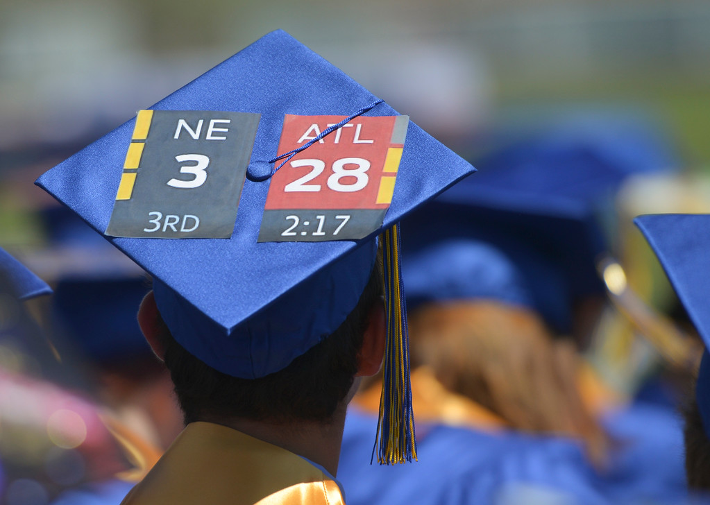Justin Sheely | The Sheridan Press<br /> A graduate wears a mortarboard with a reference to the last Super Bowl during the 2017 graduation ceremony Saturday at Sheridan High School.