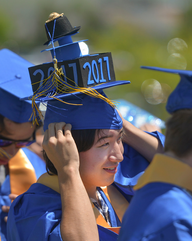 Justin Sheely | The Sheridan Press<br /> Bailey Bennett waits outside the field with the graduates during the 2017 graduation ceremony Saturday at Sheridan High School.
