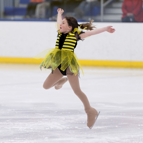 "Tibby McDowell | The Sheridan Press<br /> Khloe Thomas leaps while skating to the song ""Walkin' on Sunshine"" during the Sheridan Ice's 9th Annual Ice Show at Whitney Rink at  M&M's Center Tuesday, March 27, 2018."