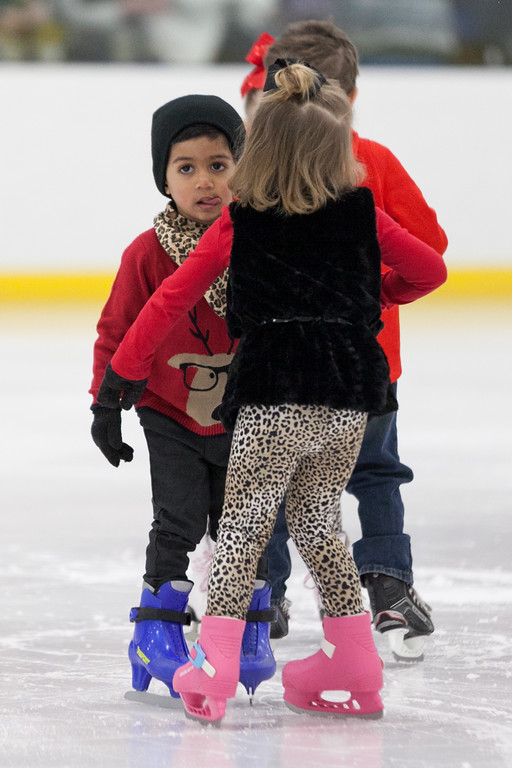 "Tibby McDowell | The Sheridan Press<br /> 3-year-old Viaan Kerkar sticks his tongue out in concentration while performing ""Moose Mambo"" during the Sheridan Ice's 9th Annual Ice Show at Whitney Rink at  M&M's Center Tuesday, March 27, 2018."