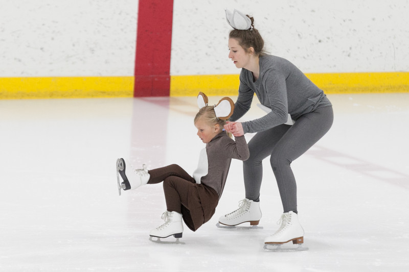 "Tibby McDowell | The Sheridan Press<br /> Kairstyn Holden, right, holds up Charlotte Martineau while performing a duet to ""Tom and Jerry"" during the Sheridan Ice's 9th Annual Ice Show at Whitney Rink at  M&M's Center Tuesday, March 27, 2018."