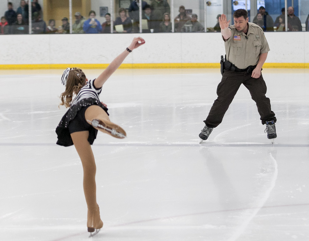 "Tibby McDowell | The Sheridan Press<br /> Genavieve Thums, left, had a guest performance with her dad Gabe while performing to ""Jailhouse Rock"" during the Sheridan Ice's 9th Annual Ice Show at Whitney Rink at  M&M's Center Tuesday, March 27, 2018."