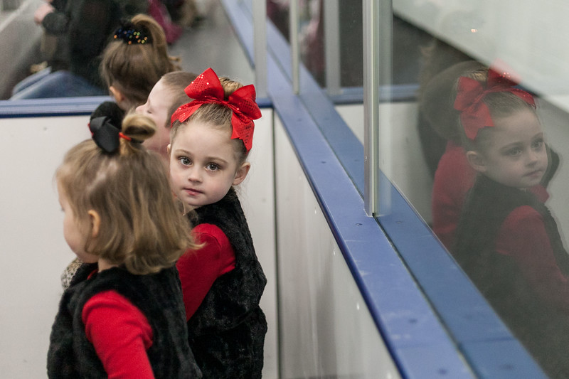 Tibby McDowell | The Sheridan Press<br /> 4-year-old Paisley Brinkerhoff peeks around a fellow skater before the Sheridan Ice's 9th Annual Ice Show at Whitney Rink at  M&M's Center Tuesday, March 27, 2018.