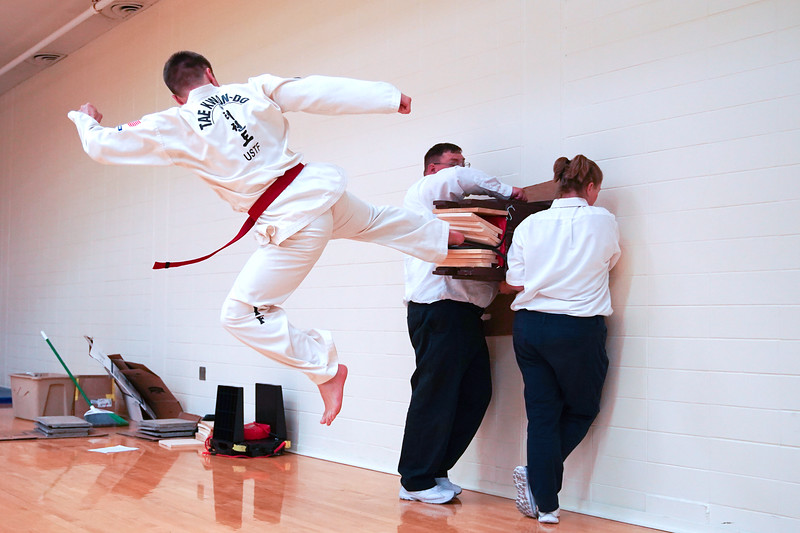 Matthew Gaston | The Sheridan Press<br /> Jared Juergens performs a high flying side kick to break four boards during his Taekwon-Do black belt test Saturday, June 13, 2020.