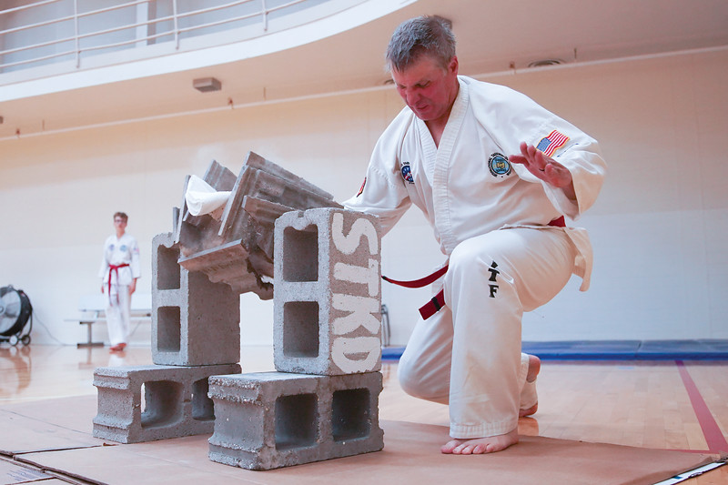 Matthew Gaston | The Sheridan Press <br /> Sheridan Fire Rescue's Paul Juergensshatters four tiles during his Taekwon-Do black belt test Saturday, June 13, 2020.