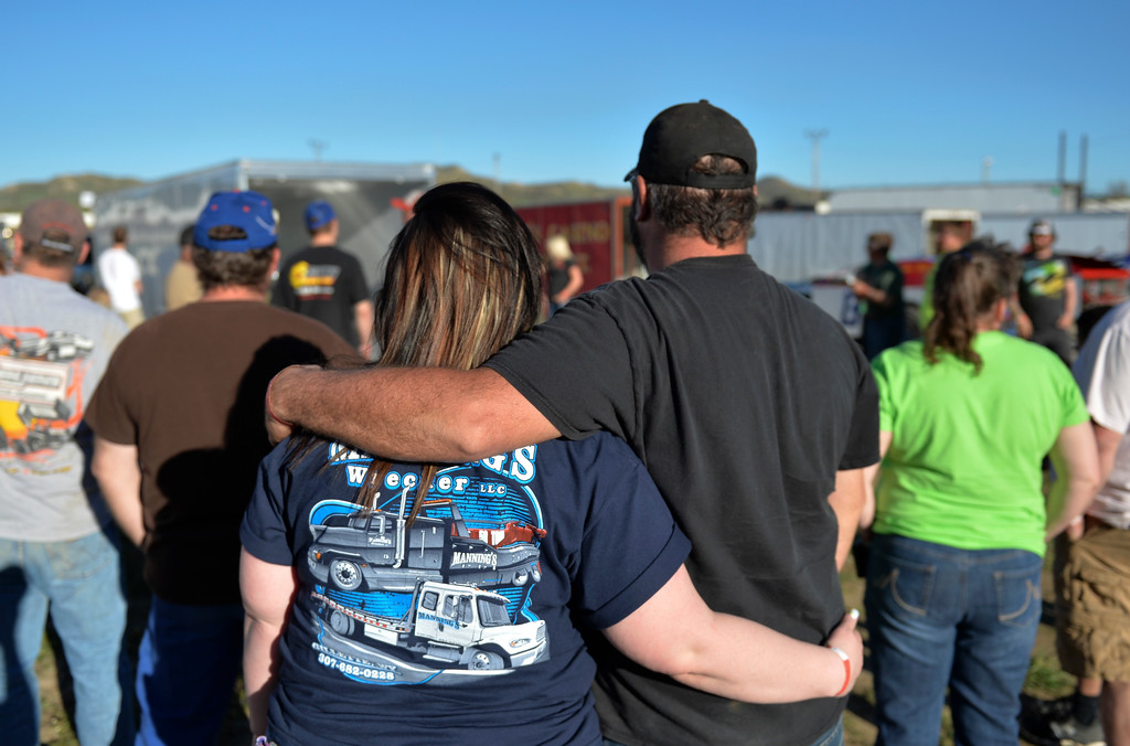 Justin Sheely | The Sheridan Press<br /> People gather for a drivers meeting in the track pit during the opening race day for the season Friday at Sheridan Speedway. Dirt track racing is has been a long-held favorite summer activity for Sheridan spectators, drivers and organizers. The site reopened in spring of 2015 after being vacant for five years. This month's racing schedule is set on Friday, May 12 and 19, and Thursday, May 25.