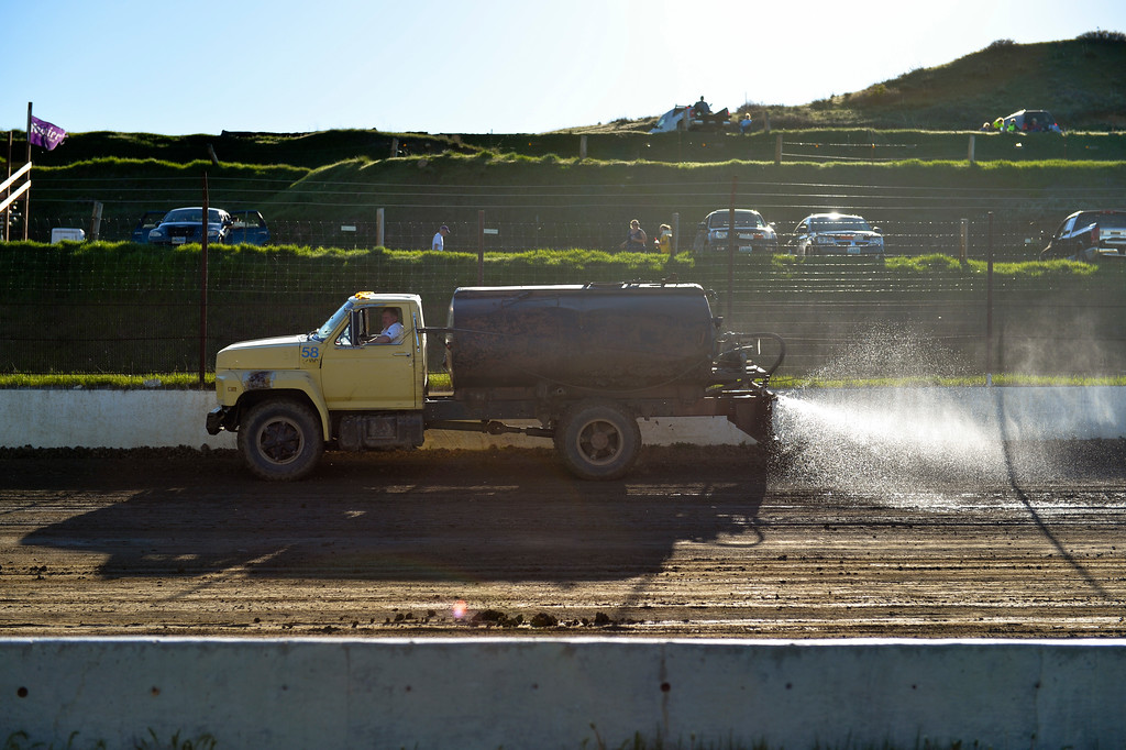 Justin Sheely | The Sheridan Press<br /> A water truck keeps the track wet prior the event during the opening race day for the season Friday at Sheridan Speedway. Dirt track racing is has been a long-held favorite summer activity for Sheridan spectators, drivers and organizers. The site reopened in spring of 2015 after being vacant for five years. This month's racing schedule is set on Friday, May 12 and 19, and Thursday, May 25.