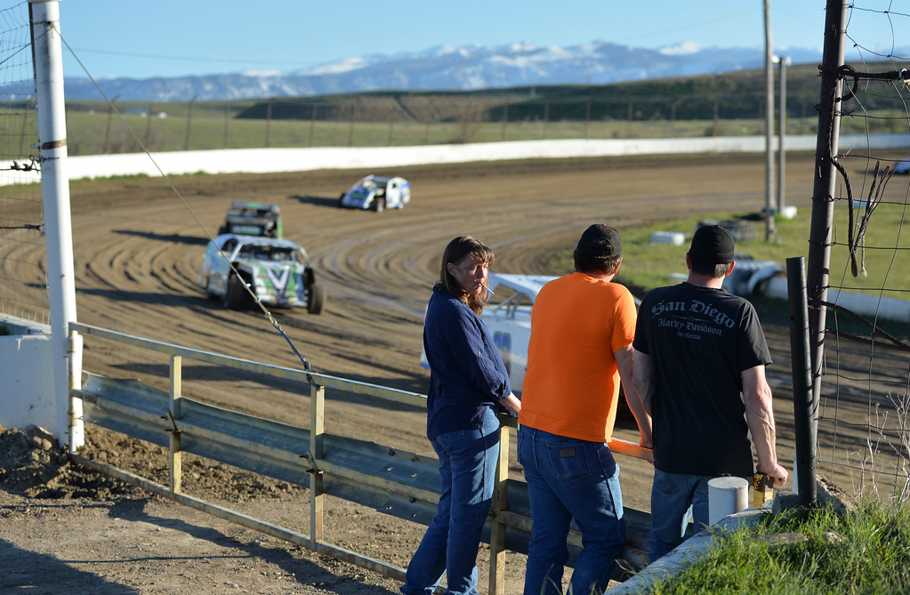 Justin Sheely | The Sheridan Press<br /> Track crew watch as Mod-4 cars pace along the track during the opening race day for the season Friday at Sheridan Speedway. Dirt track racing is has been a long-held favorite summer activity for Sheridan spectators, drivers and organizers. The site reopened in spring of 2015 after being vacant for five years. This month's racing schedule is set on Friday, May 12 and 19, and Thursday, May 25.