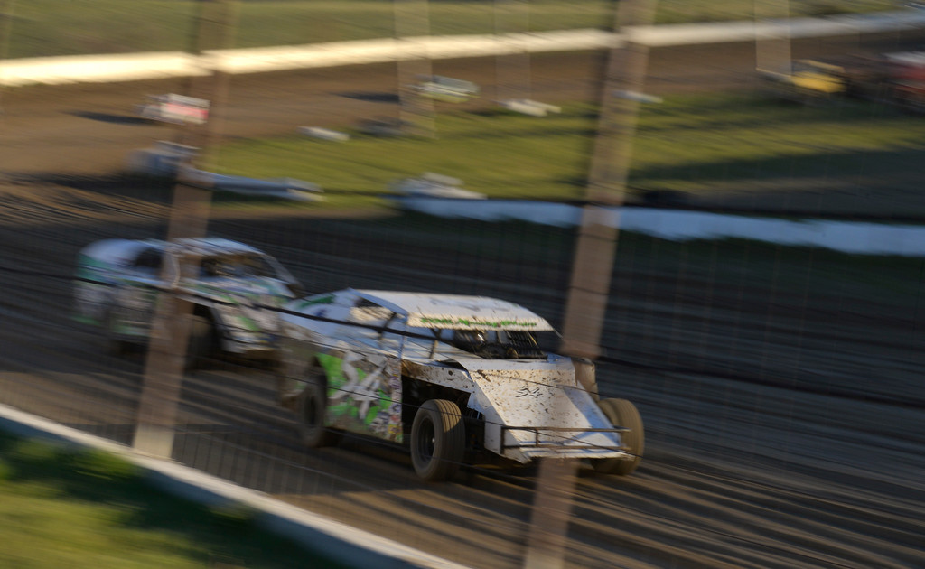 Justin Sheely | The Sheridan Press<br /> Drivers charge down the dirt track during the opening race day for the season Friday at Sheridan Speedway. Dirt track racing is has been a long-held favorite summer activity for Sheridan spectators, drivers and organizers. The site reopened in spring of 2015 after being vacant for five years. This month's racing schedule is set on Friday, May 12 and 19, and Thursday, May 25.