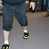 The shoe parade begins! Mike Tysor and his Hawkeye slippers.