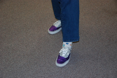 """Theresa Cassiday's purple and silver """"football mom"""" shoes."""