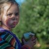 Brooke Robie of Sterling munches on an apple bigger than her hands at Sholan Farms' Harvest Festival Weekend in Leominster. SENTINEL&ENTERPRISE/ Jim Marabello