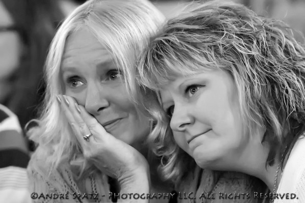 "Emotions: Debbie vanWolde and Lisa Hardiman during Iron Cowboy's John Davis new song: ""Too Soon"""