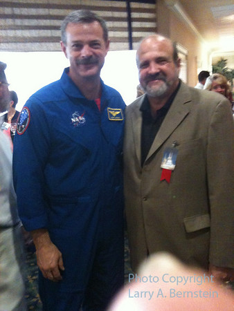 Astronaut Scott Altman and Larry. Captain Altman was mission commander for the Hubble repair mission