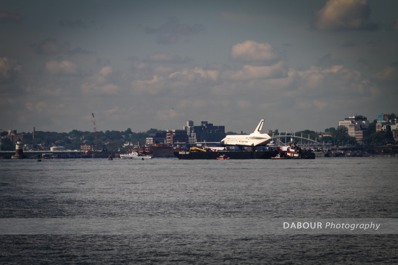 Shuttle Enterprise begins its departure from NJ to NYC on barge