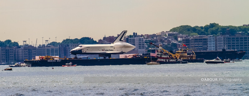 Space Shuttle Enterprise on its final voyage as it floats by near Liberty State Park.