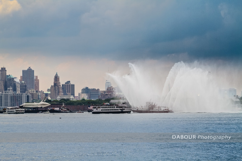 Enterprise Shuttle receives some celabratory water spray from the FDNY boats near Liberty State Park. Express-Times photo by | DAVE DABOUR