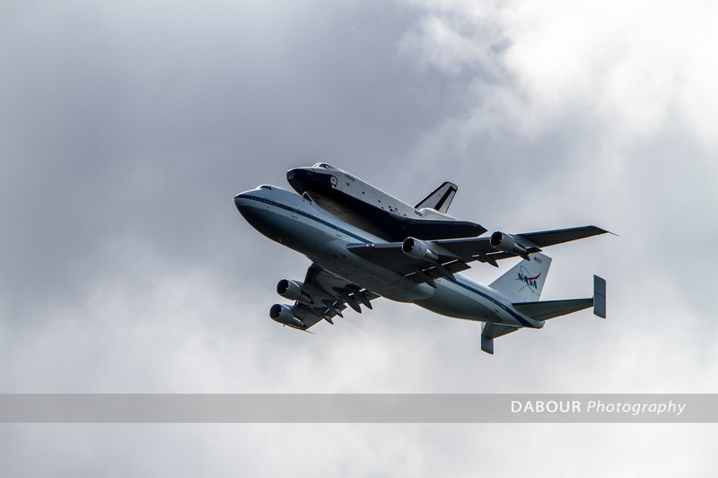 The space shuttle Enterprise makes its final voyage near Libery State Park in NJ.