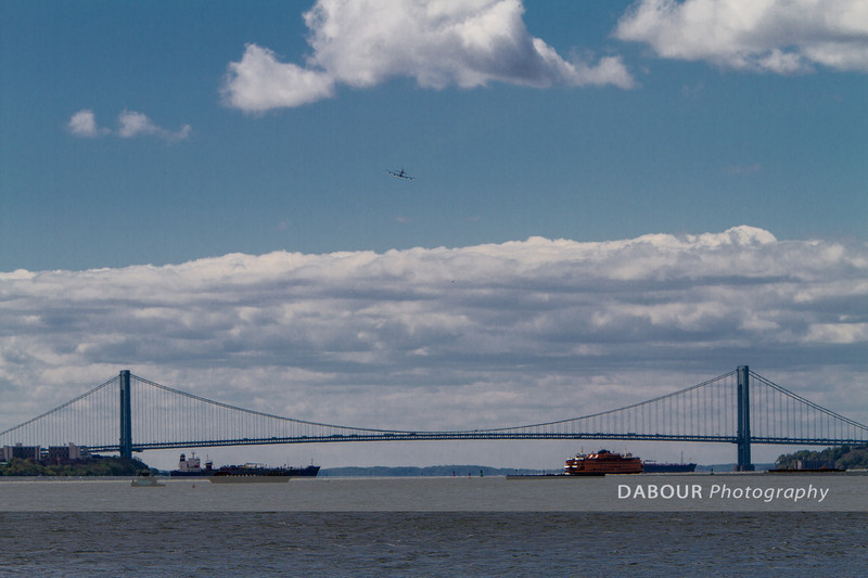 The space shuttle Enterprise makes its final pass near Libery State Park in NJ.