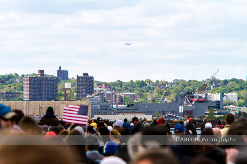 Space Shuttle Enterprise flying over eastern NJ as seen from many spectators at Liberty State Park.
