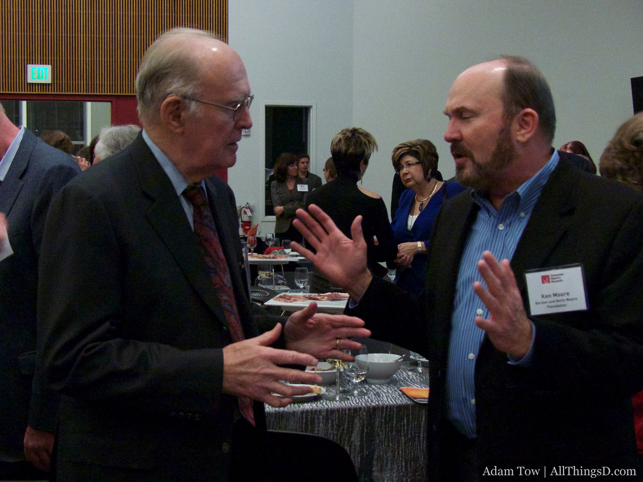 Gordon Moore, founder of Intel, speaks with his son, Ken Moore following the event.