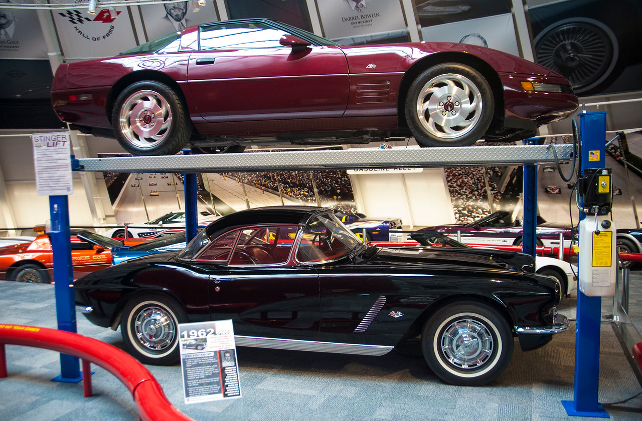 The 1993 Ruby Red 40th Anniversary Corvette and 1962 Black Corvette, both donated to the Museum.  In the background to the left you can also see the PPG Pace Car.  Permission given to use this image with credit to the National Corvette Museum