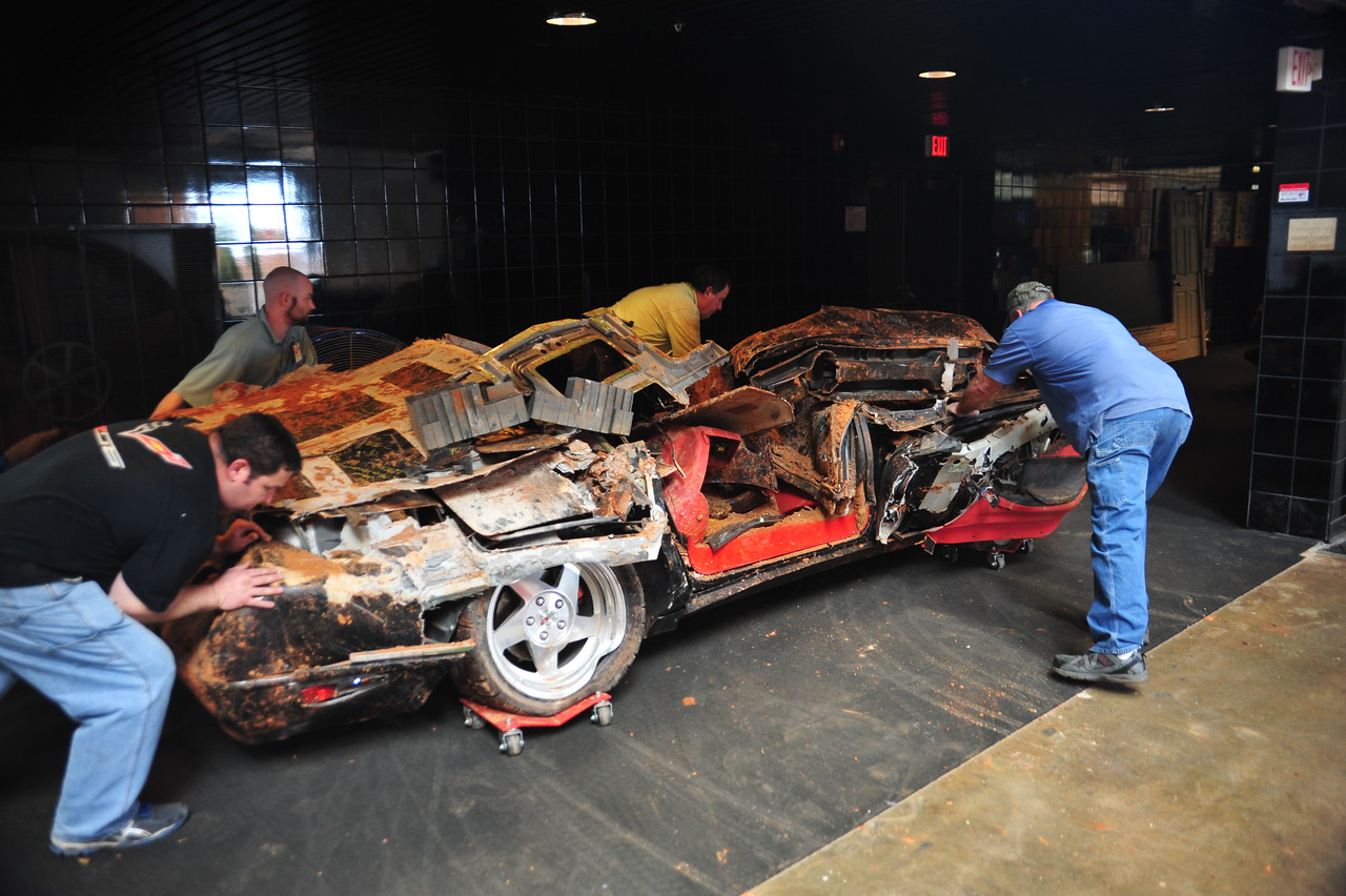 Museum team members help push the 1993 ZR-1 Spyder from it's display spot within the Skydome, to a new display spot in the tunnel leading into the Skydome. The car was moved to make way for construction equipment.