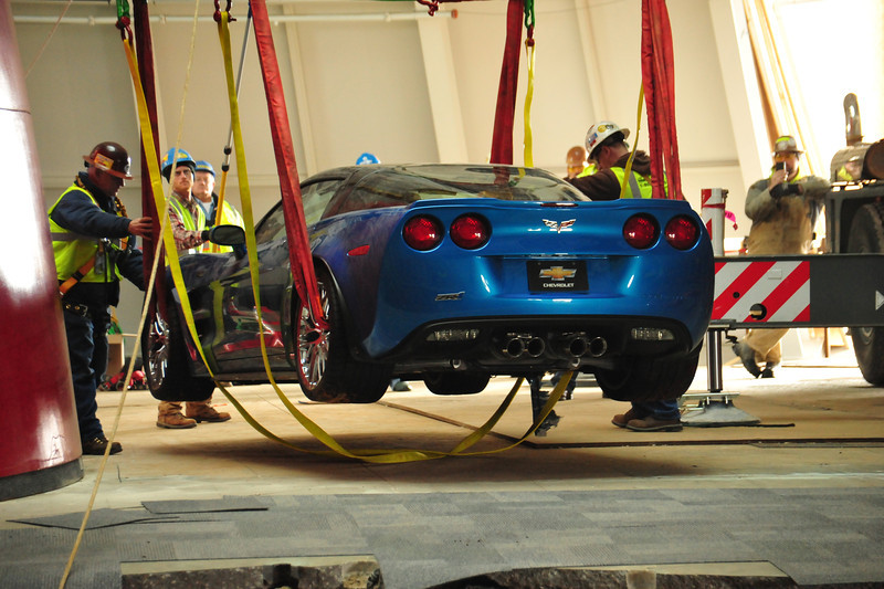 Workers placing the recovered 2009 ZR1 on stable ground   Permission given to use this image with credit to the National Corvette Museum