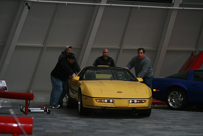 Museum staff removing the remaining cars in the Skydome  Permission given to use this image with credit to the National Corvette Museum
