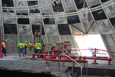 Removing lower panels and beginning stabilization of the sinkhole.   Permission given to use this image with credit to the National Corvette Museum