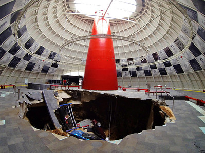 "National Corvette Museum Skydome Sinkhole: Pictured in the sinkhole: 1962 Black Corvette, 1993 40th Anniversary Ruby Red,the 2009 ""Blue Devil"" ZR1 and 1 millionth Corvette (under '62)  Permission given to use this image with credit to the National Corvette Museum"