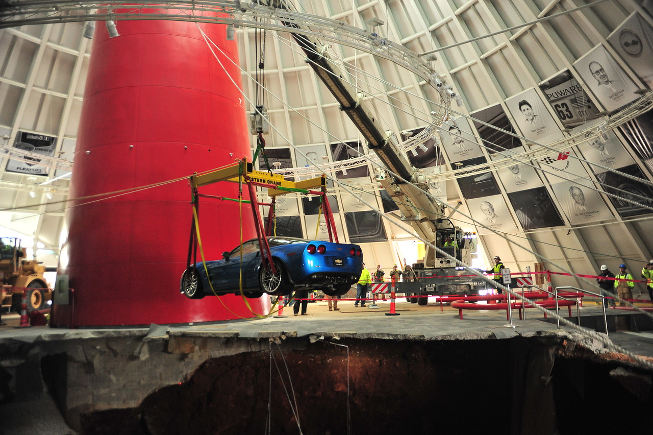 "2009 ""Blue Devil"" ZR1 being pulled up from the sinkhole  Permission given to use this image with credit to the National Corvette Museum"