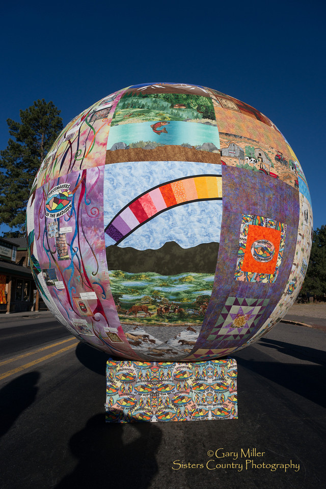 Globular Quilt in the shape of a ball made by the the Piecemakers of the Madison at the 2013 Sisters Outdoor Quilt Show - The largest outdoor quilt show in the world with over 1,300 quilts on display and was held in Sisters, Oregon on July 13, 2013 - Copyright © 2013 Gary N. Miller, Sisters Country Photography
