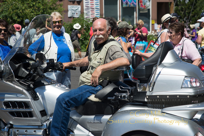 "Photographer Gary N. Miller plays with the gals as these ""Motor Maids"" rode their motorcycles to Central Oregon from Michigan and stopped in to enjoy the 2013 Sisters Outdoor Quilt Show, the largest outdoor quilt show in the world with over 1,300 quilts on display and was held in Sisters, Oregon on July 13, 2013 - Copyright © 2013 Gary N. Miller, Sisters Country Photography"