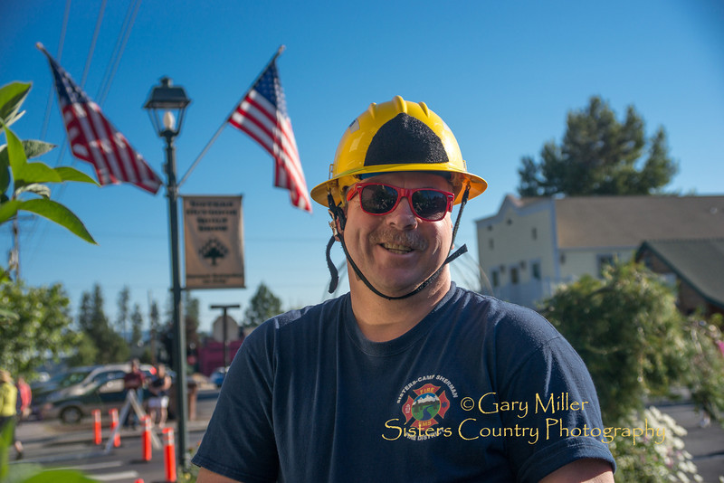 Sisters Fireman Bill Hayes at the 2013 Sisters Outdoor Quilt Show - The largest outdoor quilt show in the world with over 1,300 quilts on display and was held in Sisters, Oregon on July 13, 2013 - Copyright © 2013 Gary N. Miller, Sisters Country Photography