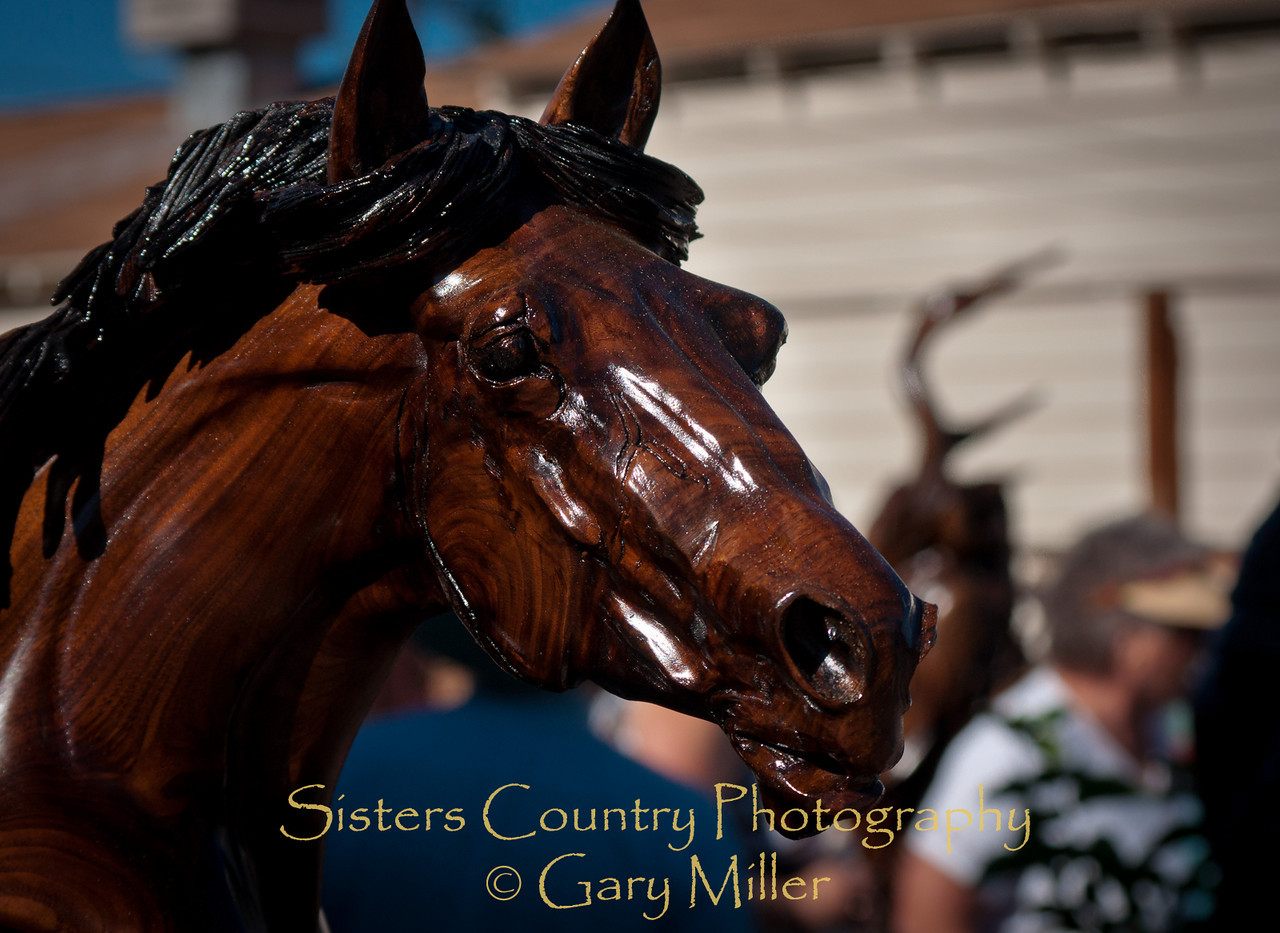 The art work of J. Chester (Skip) Armstrong graces the Sisters Outdoor Quilt Show 2010 - Gary Miller - Sisters Country Photography