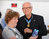 SKY BALL 2013<br /> MEDAL OF HONOR RECIPIENT JAMES FLEMING, USAF RETIRED, obliges a guest in the VIP tent with a photo.