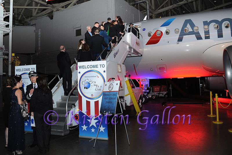SKY BALL 2013  <br /> Guests wait in line to take a tour of one of American's new 319 Airbuses.