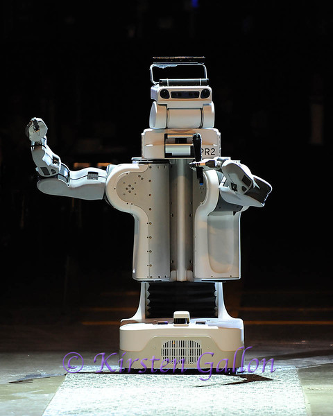 SKY BALL 2013<br /> UTA Research Institute Robot PR2 talks to the crowd as he works his was down the aisle.