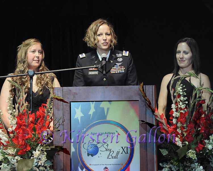 SKY BALL 2013 <br /> Medivac Pilot Jessica Brewington speaks to the attendees while fellow medivac team members Crew Chief Deanna Helfrich stands to her left and medic Stephanie Luke stands to her right. They are the only all female medivac team.