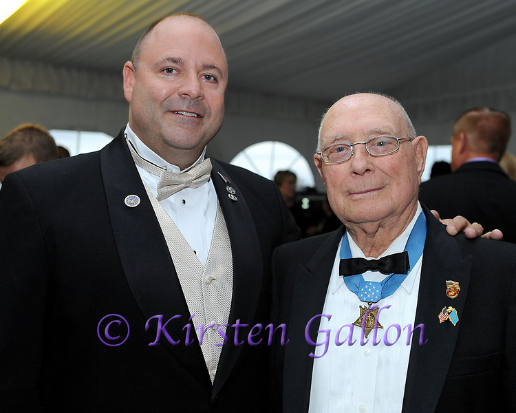 "SKY BALL 2013 <br /> BRENT CASEY and his grandfather HERSHEL ""WOODY"" WILLIAMS. Mr. Williams is a Medal of Honor recipient and is one of the soldiers pictured in the iconic photo of the raising of the flag in the Battle of Iwo Jima, February 23, 1945.  Mr. Casey is also a veteran and travels with his grandfather to events around the country as well as serving as the staff photographer for the Congressional Medal of Honor Society."