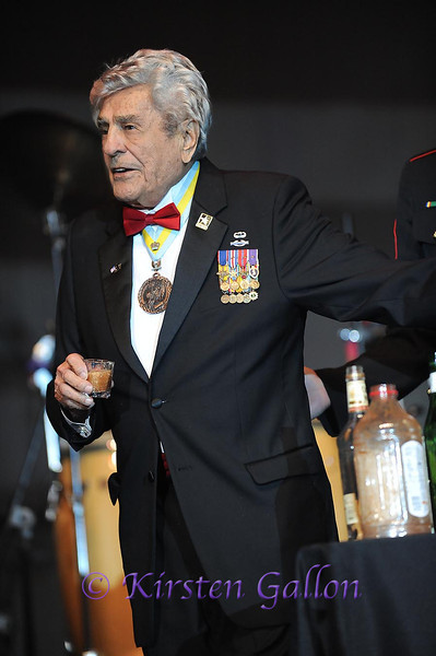 "SKY BALL 2013 <br /> Lt. Colonel Ret., James ""Maggie"" Magellas, the most decorated soldier of WW II 's 82nd Airborne, prepares to give a taste of the official ""Grog"", to see if it is fit for human consumption."