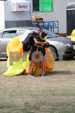 Sky Diver Greg Nore is welcomed back by Riley Gillispie